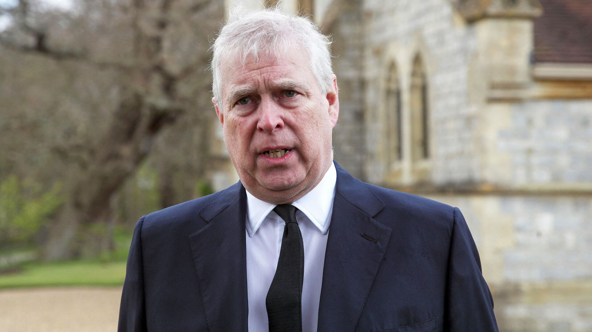 Britain's Prince Andrew, Duke of York, speaks during a television interview outside the Royal Chapel of All Saints in Windsor on April 11, 2021, two days after the death of his father Britain's Prince Philip, Duke of Edinburgh. - Sputnik International, 1920, 21.09.2021
