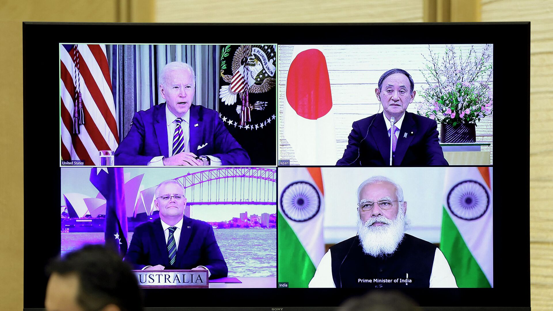 A monitor displaying a virtual meeting with U.S. President Joe Biden (top L), Australia's Prime Minister Scott Morrison (bottom L), Japan's Prime Minister Yoshihide Suga (top R) and India's Prime Minister Narendra Modi is seen during the virtual Quadrilateral Security Dialogue (Quad) meeting, at Suga's official residence in Tokyo on March 12, 2021. - Sputnik International, 1920, 21.09.2021