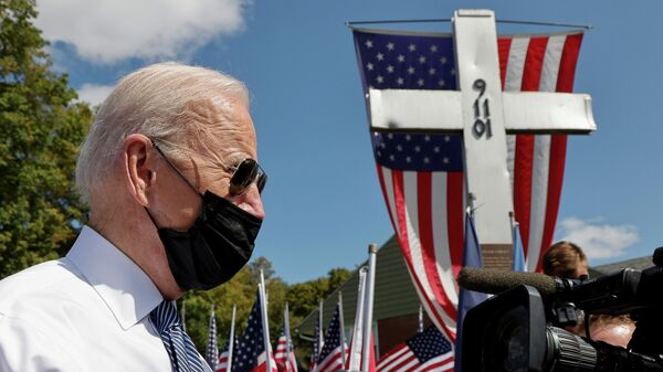 U.S. President Joe Biden speaks to reporters before paying his respects at a 9/11 memorial outside the Shanksville volunteer fire station, as he and first lady Jill Biden stopped at the fire hall after visiting the nearby site where the hijacked United Airlines Flight 93 plane crashed, on the 20th anniversary of the September 11, 2001 attacks, in Shanksville, Pennsylvania, U.S., September 11, 2021. Biden has repeatedly visited the firehouse over the years since 2001. - Sputnik International