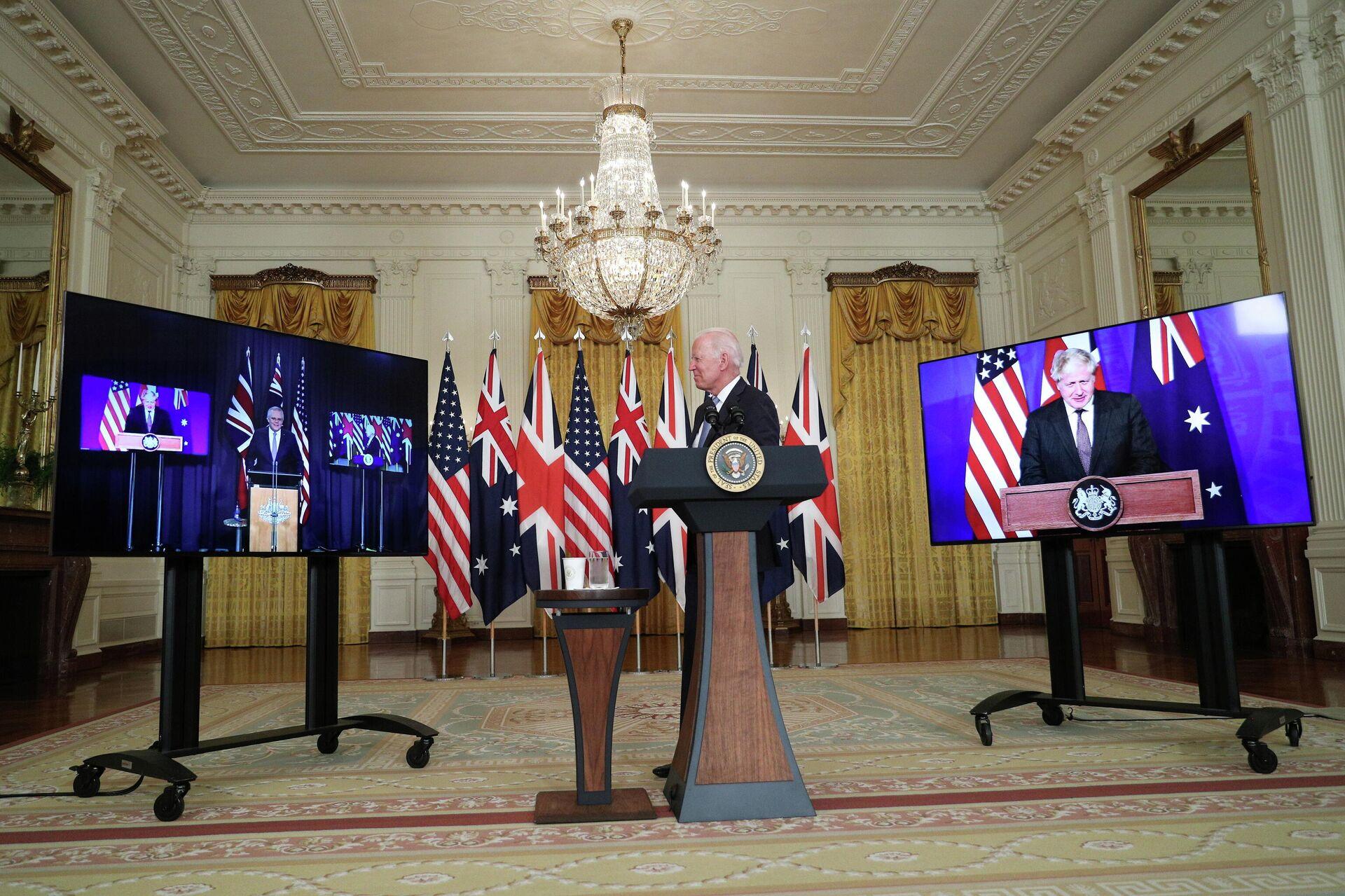 U.S. President Joe Biden delivers remarks on a National Security Initiative virtually with Australian Prime Minister Scott Morrison and British Prime Minister Boris Johnson, inside the East Room at the White House in Washington, U.S., September 15, 2021 - Sputnik International, 1920, 17.09.2021