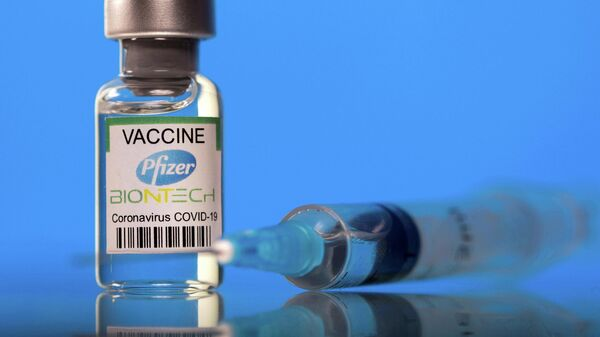 A vial labelled with the Pfizer-BioNTech coronavirus disease (COVID-19) vaccine is seen in this illustration picture taken March 19, 2021. - Sputnik International