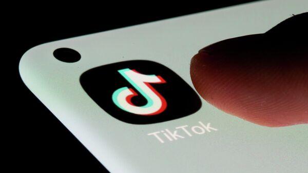 TikTok app is seen on a smartphone in this illustration taken, July 13, 2021 - Sputnik International