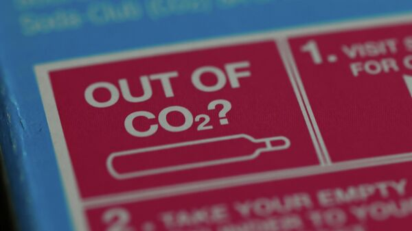 An information label is seen on packaging for a CO2  cylinder for a fizzy drinks machine in Manchester, Britain, September 20, 2021 - Sputnik International