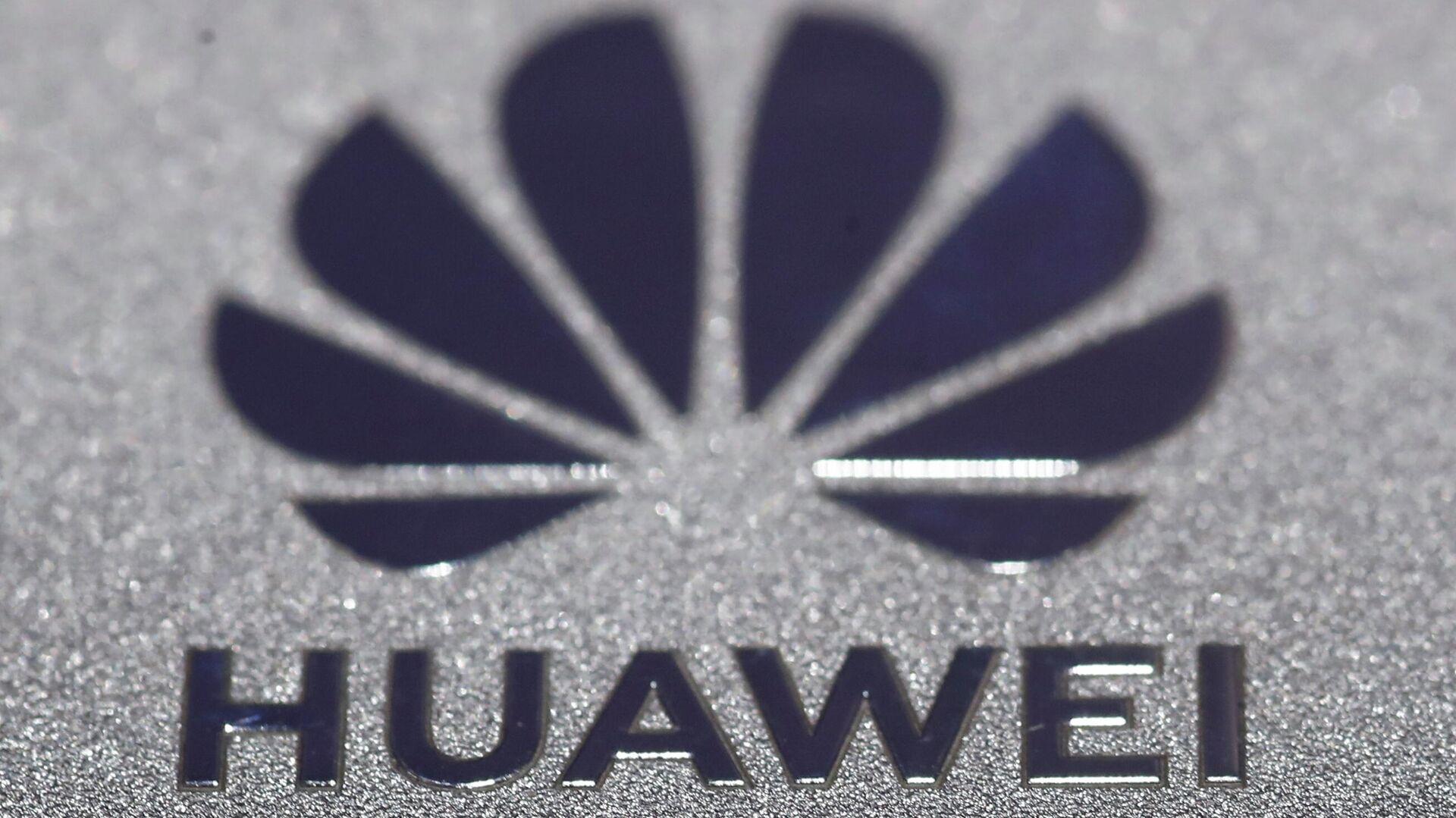 Huawei logo is seen during Munich Auto Show, IAA Mobility 2021 in Munich, Germany, September 8, 2021. REUTERS/Wolfgang Rattay - Sputnik International, 1920, 25.09.2021
