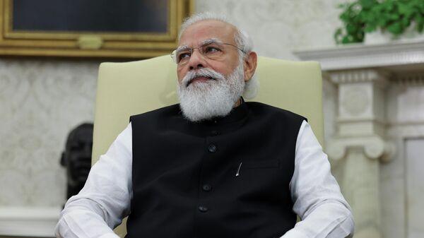 India's Prime Minister Narendra Modi participates in a bilateral meeting with U.S. President Joe Biden in the Oval Office at the White House in Washington, U.S., September 24, 2021.  - Sputnik International