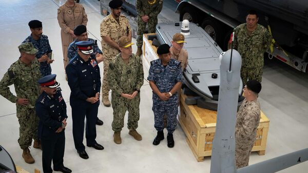 NAVAL SUPPORT ACTIVITY BAHRAIN (Sept. 23, 2021) Vice Adm. Brad Cooper, commander of U.S. Naval Forces Central Command (NAVCENT), U.S. 5th Fleet, and Combined Maritime Forces, center right, along with Major Gen. Ala Abdulla Seyadi, commander of the Bahrain Coast Guard, center left; and Rear Adm - Sputnik International