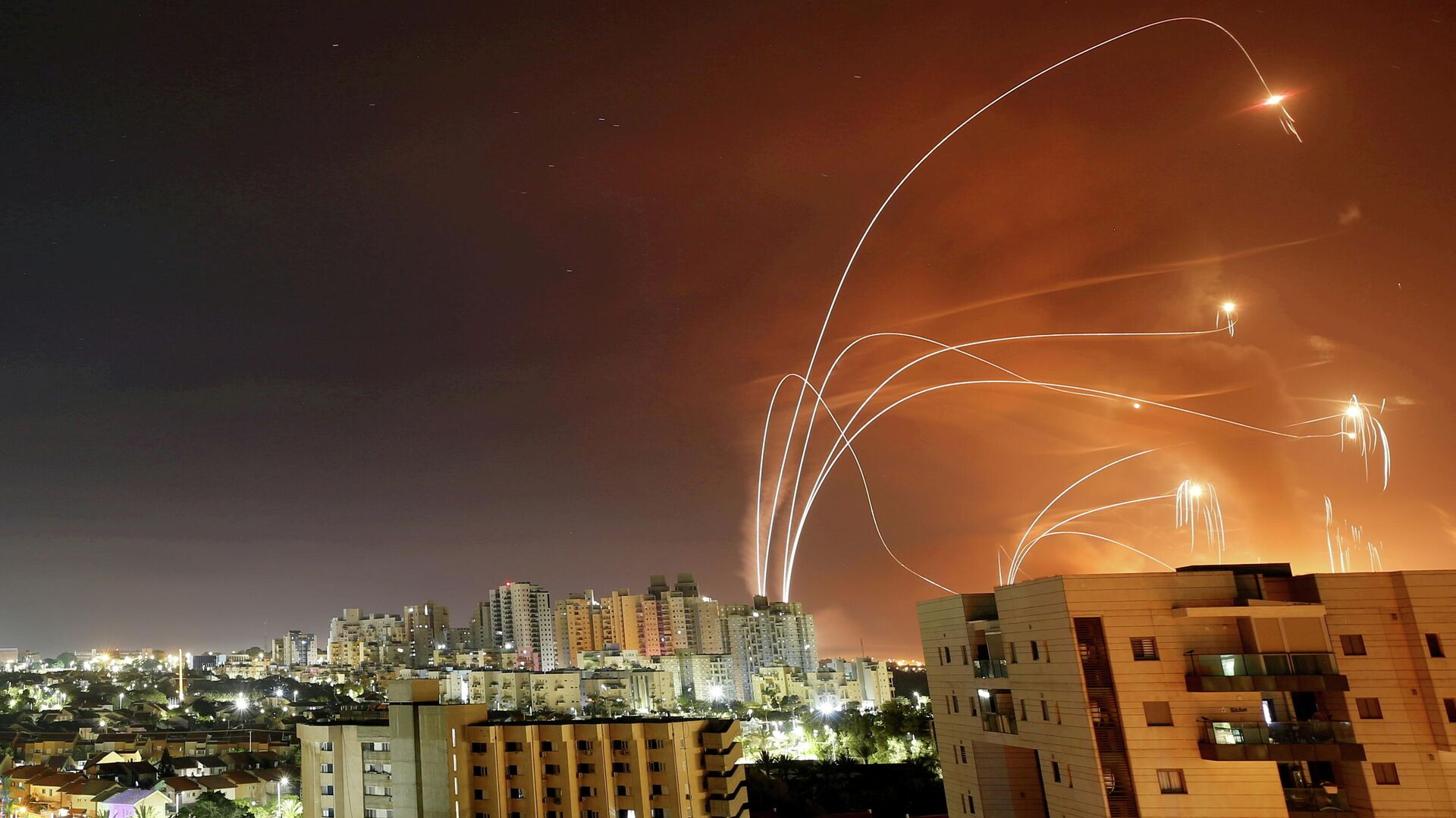 Streaks of light are seen as Israel's Iron Dome anti-missile system intercepts rockets launched from the Gaza Strip towards Israel, as seen from Ashkelon, Israel, May 12.  - Sputnik International, 1920, 29.09.2021