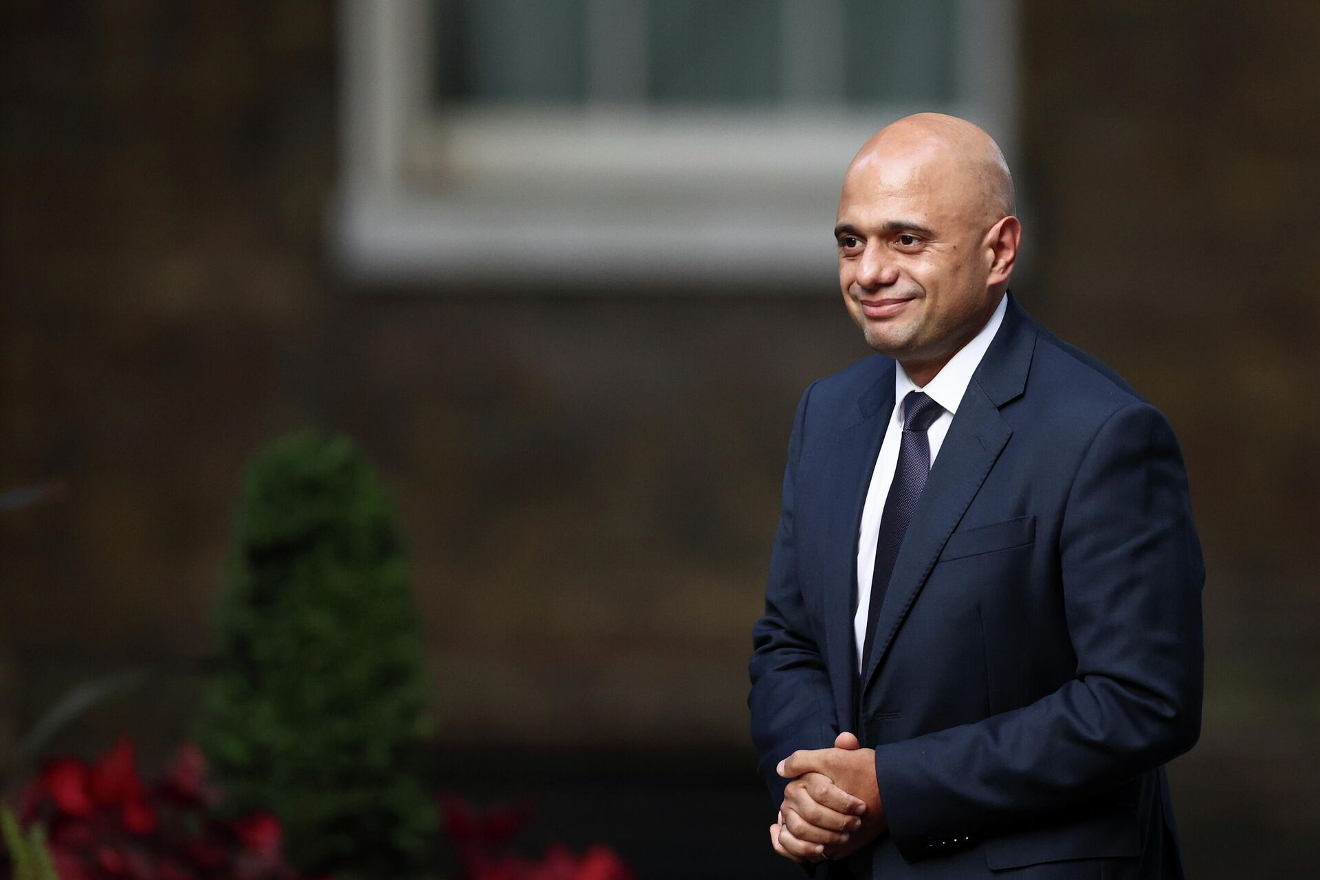 Britain's Secretary of State for Health and Social Care Sajid Javid walks outside Downing Street in London - Sputnik International, 1920, 12.10.2021