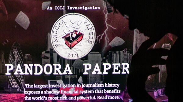 This photograph illustration shows a woman's shadow cast on the logo of Pandora Papers, in Lavau-sur-Loire, western France, on October 4, 2021 - Sputnik International
