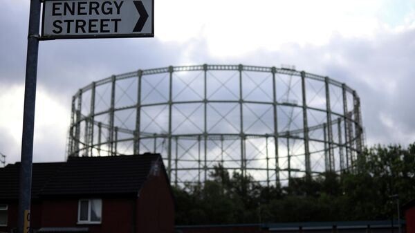 FILE PHOTO: A disused gas holder is seen behind a road sign for Energy Street in Manchester - Sputnik International