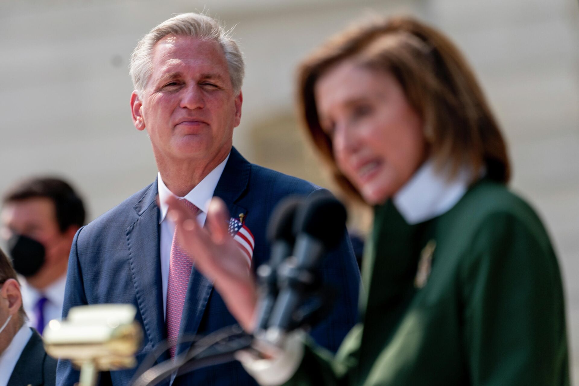 House Speaker Nancy Pelosi of Calif., right, accompanied by House Minority Leader Kevin McCarthy of Calif., left, speaks during a Congressional Remembrance Ceremony marking the 20th anniversary of the Sept. 11, 2001, terrorist attacks, on Capitol Hill in Washington, Monday, Sept. 13, 2021. - Sputnik International, 1920, 13.10.2021