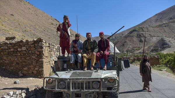Taliban fighters sit atop a Humvee in Omarz area, Panjshir Province on September 15, 2021, days after the hardline Islamist group announced the capture of the last province resisting to their rule. - Sputnik International