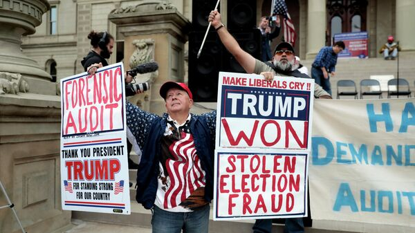 Supporters of former U.S. President Donald Trump gather outside the Michigan State Capitol to demand an audit of 2020 election votes, in Lansing, Michigan, U.S. October 12, 2021. - Sputnik International