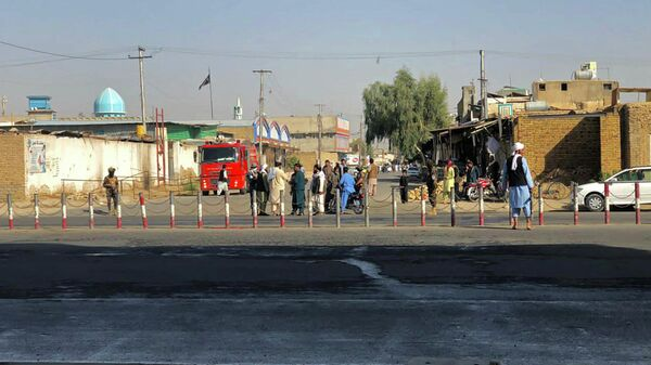 Members of Taliban stand guard near a Shiite mosque in Kandahar province on October 15, 2021, after at least 16 people were killed and 32 wounded when explosions hit a Shiite mosque - Sputnik International