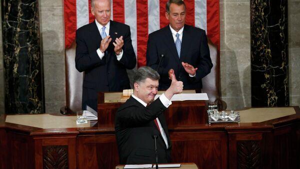 Ukraine President Petro Poroshenko gestures while addressing a joint meeting of Congress in the US Capitol in Washington, September 18, 2014 - Sputnik International