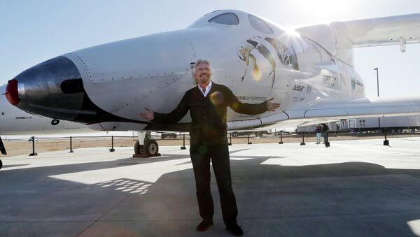 British entrepreneur Richard Branson poses with SpaceShipTwo at a Virgin Galactic hangar at Mojave Air and Space Port in Mojave, Calif. - Sputnik International