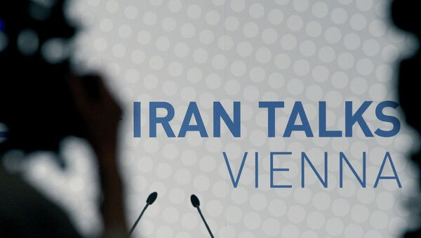 Video cameras stand in front of a poster of the Iran talks during closed-door nuclear talks at a hotel in Vienna, Austria, Tuesday, Oct. 14, 2014. - Sputnik International