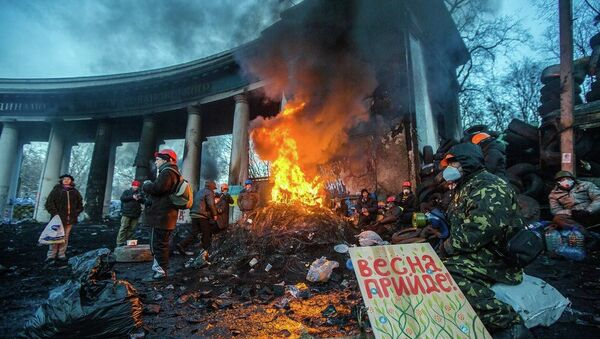 KIEV, UKRAINE - JANUARY 24: Barricade with the protesters at Hrushevskogo street on January 26, 2014 in Kiev, Ukraine. The anti-governmental protests turned into violent clashes during last week - Sputnik International