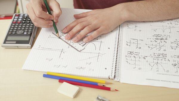 Close up of teenager doing math's homework - Sputnik International