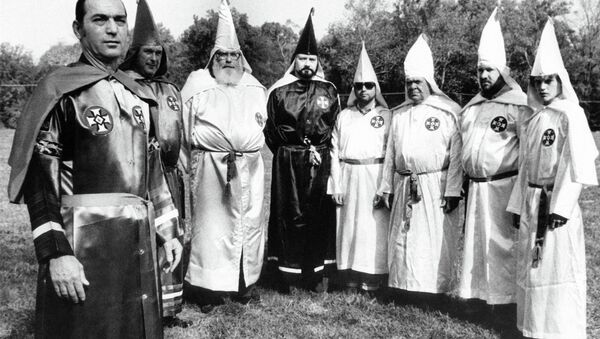 Tony La Ricci, far left, the head of the Maryland Independent Knights of the Ku Klux Klan, stands with seven members of the Klan, including Ron Glover, the fourth from the left in Baltimore, Nov. 12, 1979. - Sputnik International