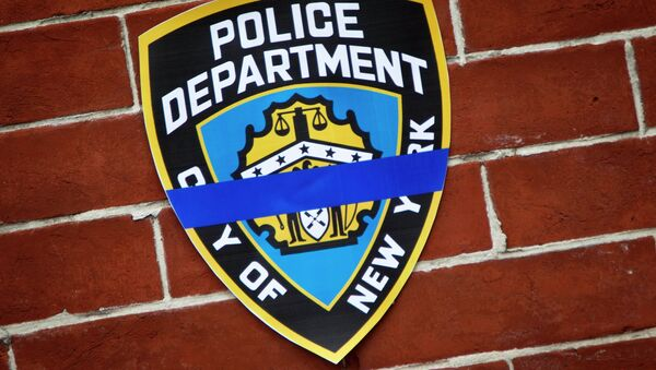 An NYPD logo is pictured on wall above makeshift memorial at the site where two police officers were shot in the head in the Brooklyn borough of New York, December 22, 2014. - Sputnik International