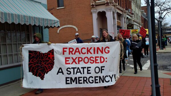 Ohio residents took to the streets to protest hydraulic fracturing, or fracking, the oil and gas drilling process expanding across the state, after a series of earthquakes were felt areas near fracking wells in March, 2014. - Sputnik International