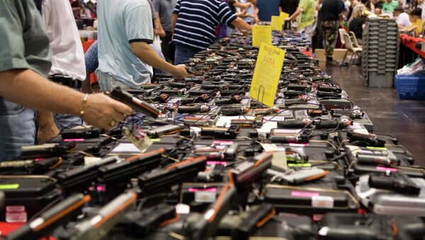 Gun sales boom in the more recent months as a result of the surge in violence in America. - Sputnik International
