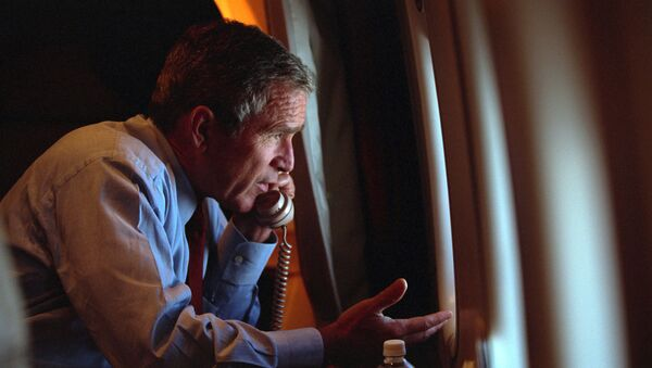 Following the terrorist attacks of Sept. 11, 2001, President George W. Bush authorized the NSA to collect Americans' phone calls and emails without warrants required by the Foreign Intelligence Surveillance Act. - Sputnik International