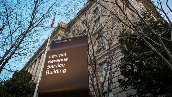 In this April 13, 2014 file photo, the Internal Revenue Service Headquarters (IRS) building is seen in Washington. The IRS is cutting taxpayer services to historically low levels just as President Barack Obama's health law will make filing a federal tax return more complicated for millions of families.  - Sputnik International