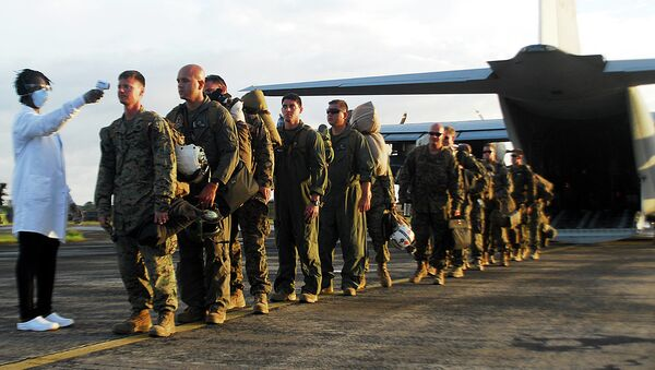 U.S. Marines stand in line to have their temperature checked as the exit the KC-130 - Sputnik International