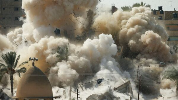 Smoke rises after a house is blown up during a military operation by Egyptian security forces in the Egyptian city of Rafah, near the border with southern Gaza Strip October 29, 2014. At least 33 Egyptian security personnel were killed on Friday in the Sinai Peninsula bordering Israel and Gaza, in an attack on a checkpoint that bore the marks of assaults claimed by Egypt's most active militant group Ansar Bayt al-Maqdis - Sputnik International