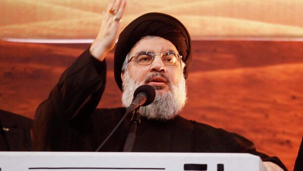 Lebanon's Hezbollah leader Sayyed Hassan Nasrallah addresses his supporters during a rare public appearance at an Ashoura ceremony in Beirut's southern suburbs November 3, 2014 - Sputnik International