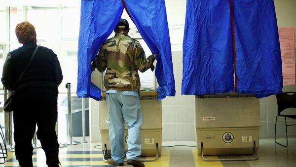 A man enters a voting booth at West Philadelphia High School on U.S. midterm election day morning in Philadelphia, Pennsylvania, November 4, 2014 - Sputnik International