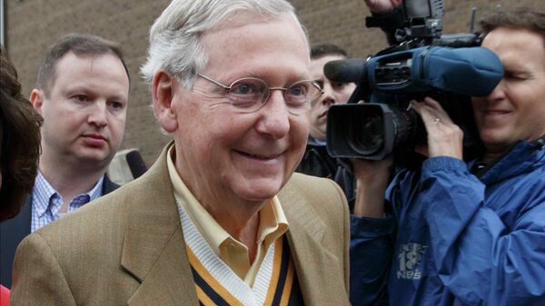 Senate Minority Leader Mitch McConnell, R-Ky., smiles after casting his ballot in the midterm election at the voting precinct at Bellarmine University in Louisville, Ky. - Sputnik International