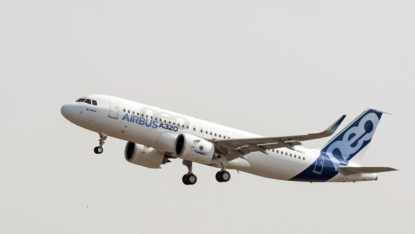 The new Airbus A320neo takes off for its first test flight at Toulouse-Blagnac airport, southwestern France, Thursday, Sept. 25, 2014 - Sputnik International
