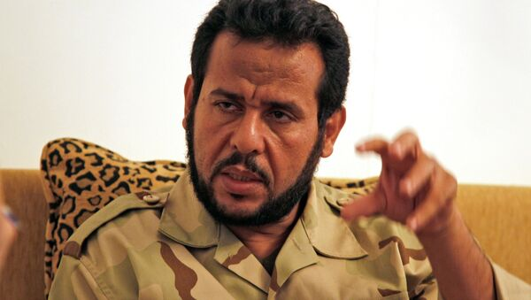 Abdel Hakim Belhaj and Sami al-Saadi, two Libyan exiles who were abducted in Southeast Asia in 2004 and sent by British and US Intelligence agencies to Libya to face punishment and torture, filed the suit in mid-October - Sputnik International
