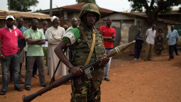An African Union (AU) soldier stands guard outside a home in the Muslim neighbourhood of Kilometre 5 (PK5) in the capital Bangui - Sputnik International