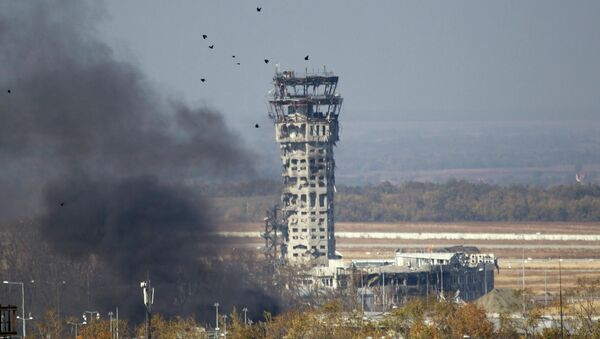 The traffic control tower of the Donetsk International Airport damaged by shelling during fighting between the independence supporters and pro-Kiev armed forces. - Sputnik International