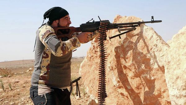 Turkey and the United States are said to have reached an agreement on training so-called moderate Syrian rebels fighting the Bashar Assad government. Photo: A Free Syrian Army fighter in Aleppo, Syria, October 3, 2014. - Sputnik International