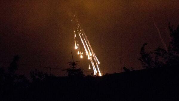 Ukrainian soldiers shoot at the village of Semyonovka with phosphorus shells - Sputnik International