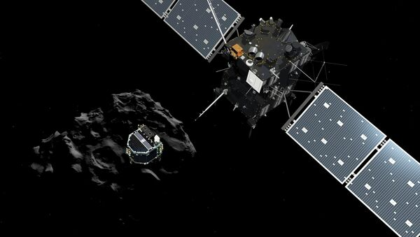 A handout artist impression showing lander Philae separating from the Rosetta spacecraft and descending to the surface of comet 67P/Churyumov-Gerasimenko, made available by the European Space Agency (ESA) on November 12, 2014. - Sputnik International