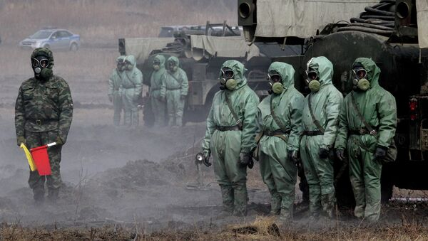 Servicemen of a radioactive and chemical protection unit during an inter-agency training exercise - Sputnik International