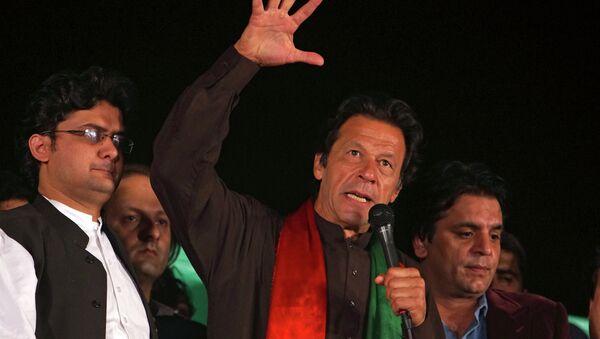 Pakistani politician Imran Khan addresses an anti-government rally near a parliament building in Islamabad, Pakistan, Tuesday, Oct. 21, 2014 - Sputnik International