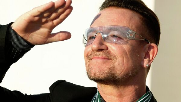 Bono, lead singer of the band U2, reacts after being awarded Commandeur des Arts et lettres (Commander in the Order of Arts and Letters) during a ceremony in Paris, in this file photo taken July 16, 2013 - Sputnik International