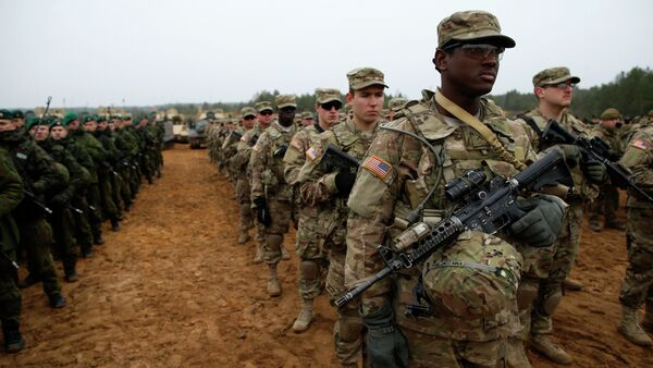Members of the U.S. Army attend a military exercise 'Iron Sword 2014', at the Gaiziunu Training Range in Pabrade some 60km.(38 miles) north of the capital Vilnius, Lithuania - Sputnik International