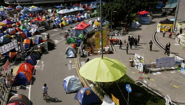 An installation in the shape of a yellow umbrella, a symbol of the Occupy Central civil disobedience movement, is seen at their Admiralty protest site in Hong Kong November 17, 2014. - Sputnik International