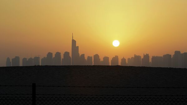 The sun sets behind the city skyline at the Marina district as the Almas tower is seen in Dubai, United Arab Emirates - Sputnik International