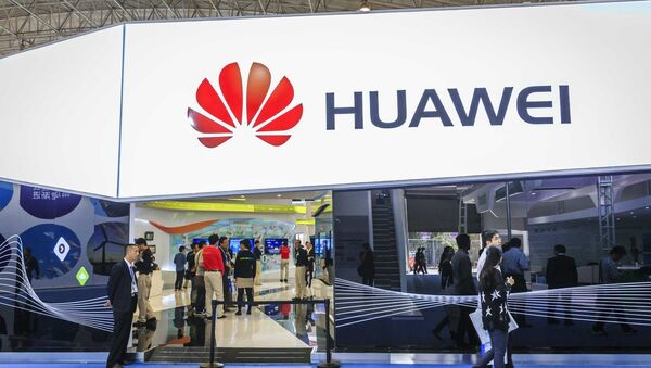 Visitors walk past the stand of Huawei during PT/EXPO COMM CHINA 2014 in Beijing, China, 27 September 2014 - Sputnik International
