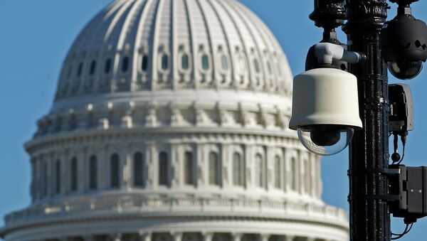 Surveillance cameras are visible near the U.S.Capitol in Washington Saturday, Oct. 26, 2013 - Sputnik International