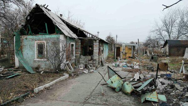 A man enters a destroyed house in the Spartak area near Sergey Prokofiev International Airport in Donetsk November 18, 2014 - Sputnik International